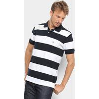 37a8364cd Camisa Polo Tommy Hilfiger Listrada Block Stripe Regular Masculina -  Masculino-Azul+Branco