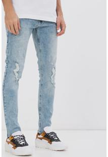 Calça Jeans Skinny Marmorizada Com Rasgos