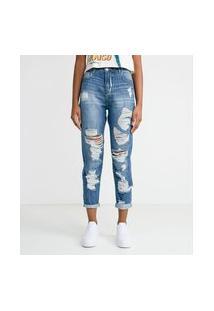 Calça Mom Em Jeans Com Puídos E Barra Dobrada