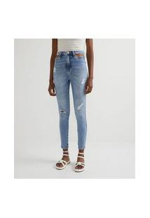 Calça Skinny Jeans Com Vazados No Espelho Do Bolso E Puídos