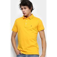 0e1c287255 Camisa Polo Tommy Hilfiger Slim Masculina - Masculino-Amarelo