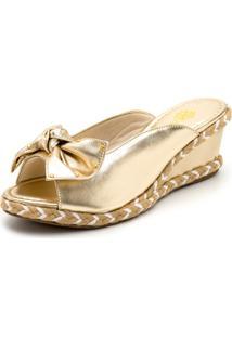 Tamanco Sandália Anabela Com Laço Salto Médio Em Dourado Metalizado