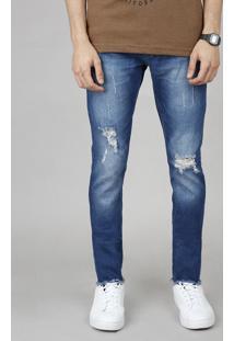 Calça Jeans Masculina Skinny Com Rasgos E Puídos Azul Médio