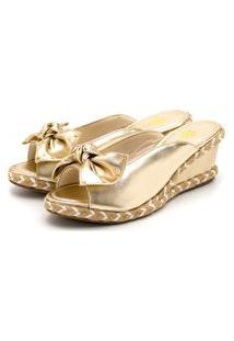 Tamanco Sandália Anabela Com Laço Salto Médio Em Dourado Metalizado Com Spike